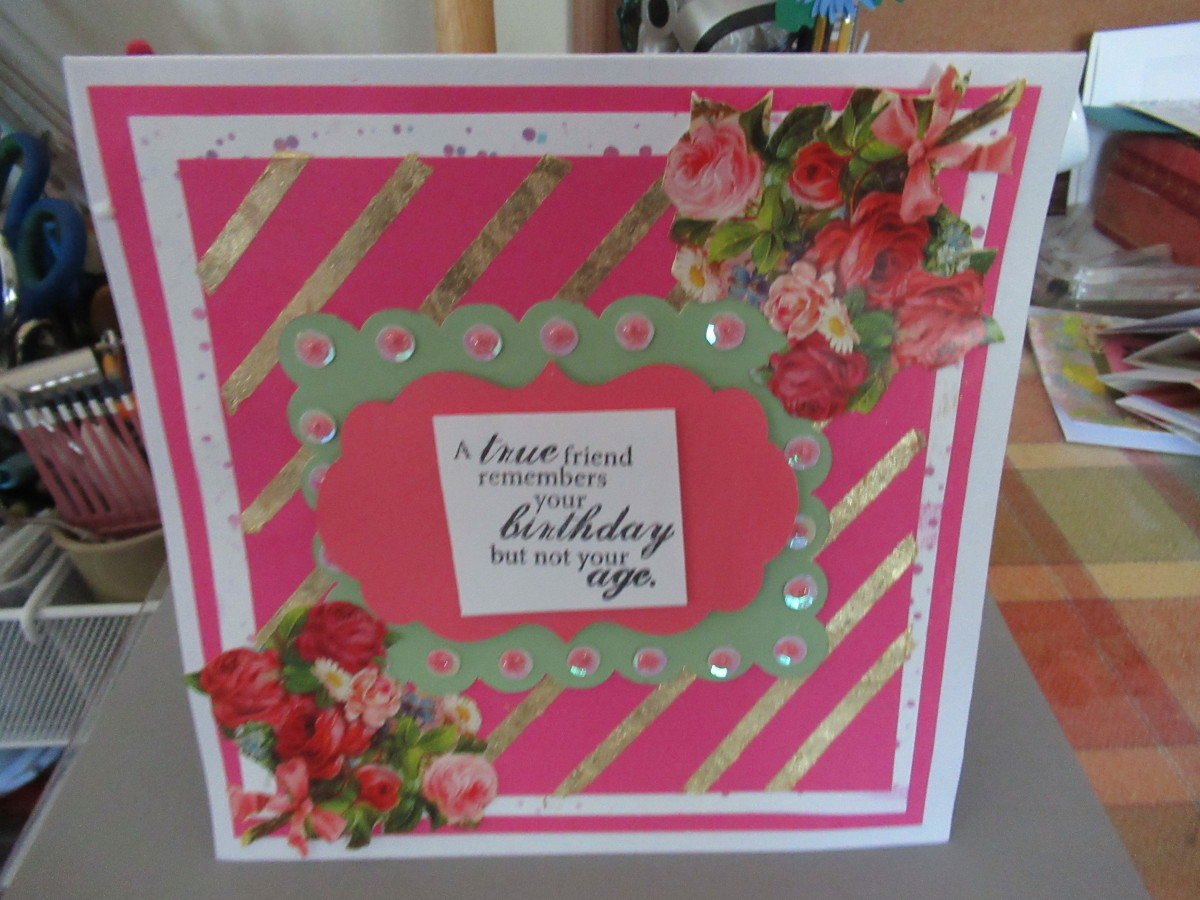 There are so many ways that you can use gilding flakes. This card uses stripes of double sided tape to greate stripes