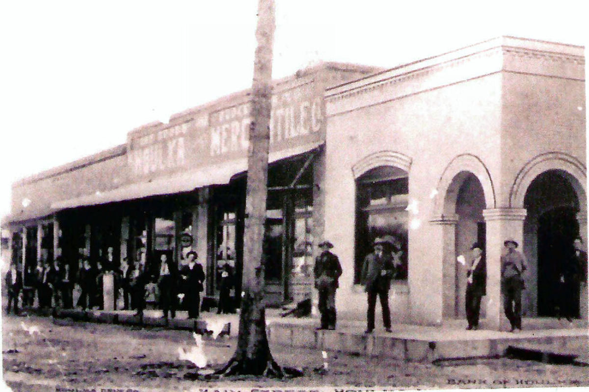 Building on right is the bank in New Houlka in early 1900s