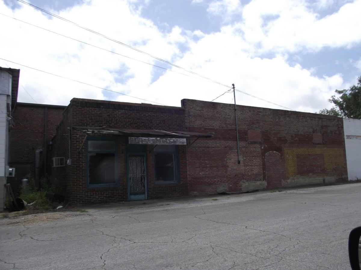 This is part of Walker Street in New Houlka. You can see where window and a door were once located on the building on the right.