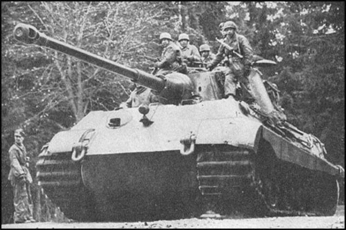 Paratroops lead the attack into Buchholz Belgium early in the Ardennes counter-offensive. With paratroops riding along on top of his tanks the town was taken without a shot fired by Kampfgruppe Peiper.