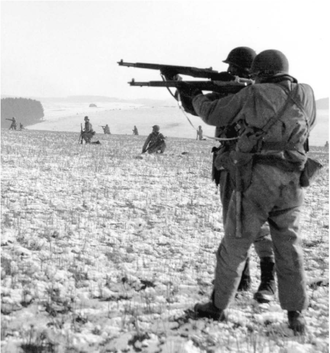 Infantry men of the Third Army battling to releive the men of the 101st Airborne in Bastogne.