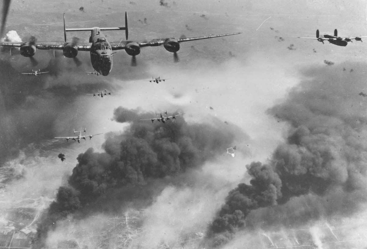 American 15th Air Force B-24s flying through flak and over the destruction created by preceding waves of bombers. Ploiești, Romania (1943). The raids on the Ploiesti oil fields took out Germany's last remaining source of oil.