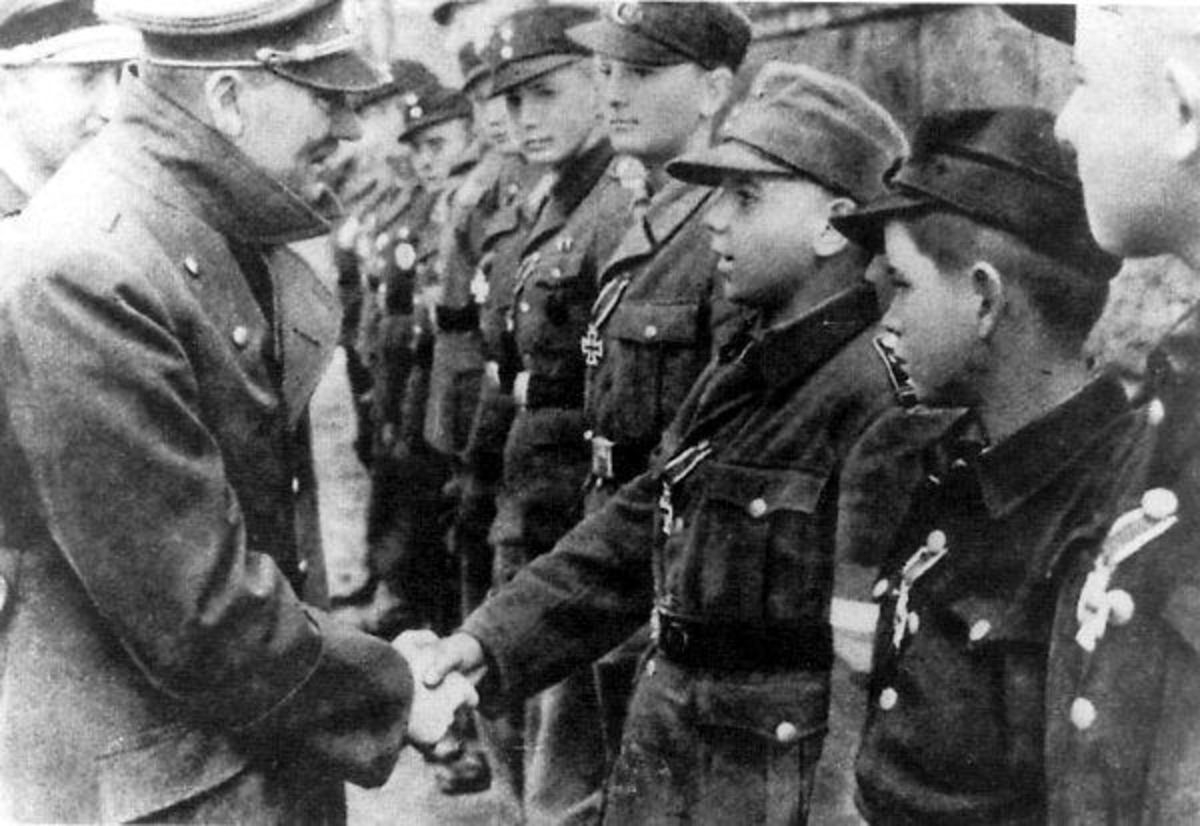 One of the last known pictures of Adolf Hitler taken during the Battle for Berlin May 1945. Hitler shaking the hands of the Hitler Youth some as young as twelve who battled the Red Army to the very gates of his bunker.