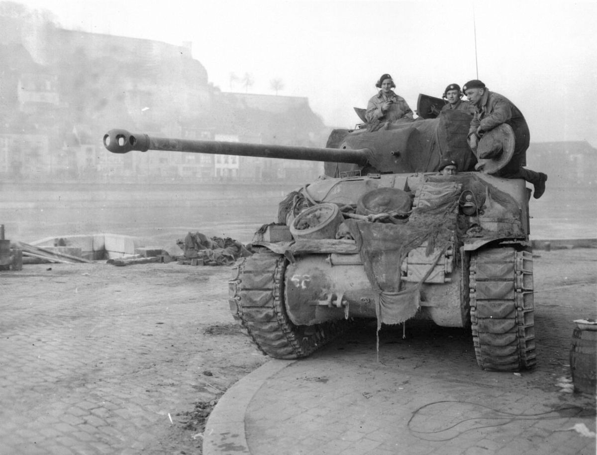 A British Sherman tank with 17 pound main gun used to battle heavier German tanks guarding a bridge over the Meuse River during the Battle of the Bulge.