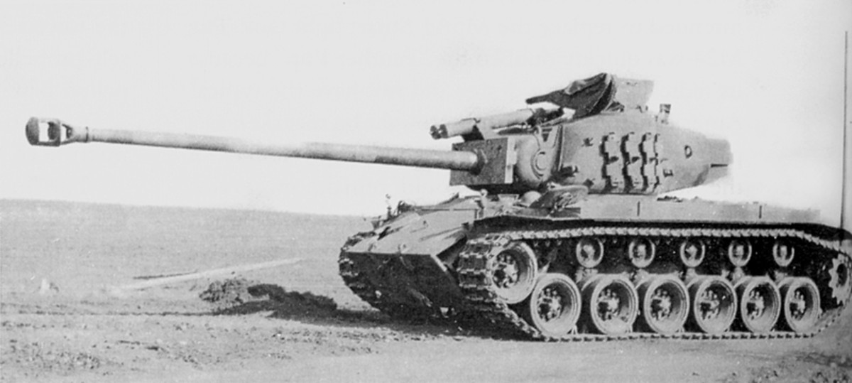 The American M26 Super Pershing tank began to arrive on the battlefield in Europe near the time of the Battle of the Bulge. Its main gun was a long barrel 90mm.