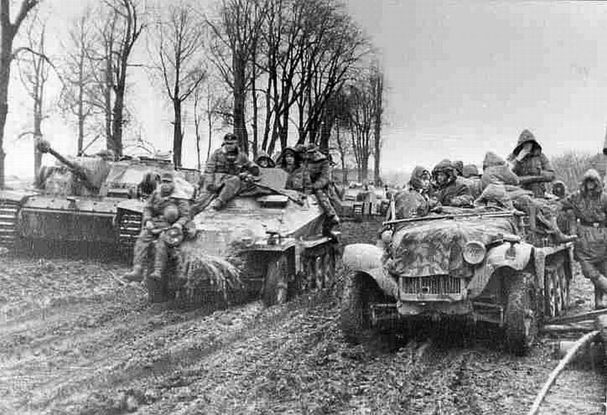 Peiper's combat group on the move in the mud and muck during the attack in the Ardennes.