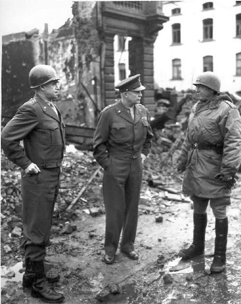 Bradley, Eisenhower and Patton (right) in Bastogne, Belgium, 1945, surveying the damage.
