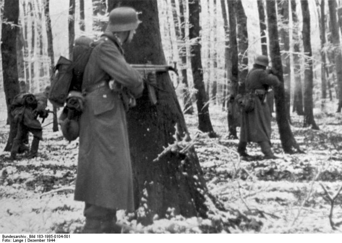 StG 44 equipped Volksgrenadiers fighting in the Ardennes. It was the first assault rifle used in combat. It was a combination of a sub machine gun and a semi automatic rifle.