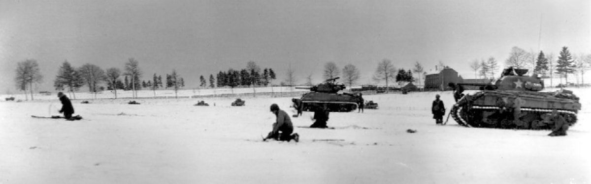 American inftanty and tanks from Patton's Third Army on the attack near Bastogne.