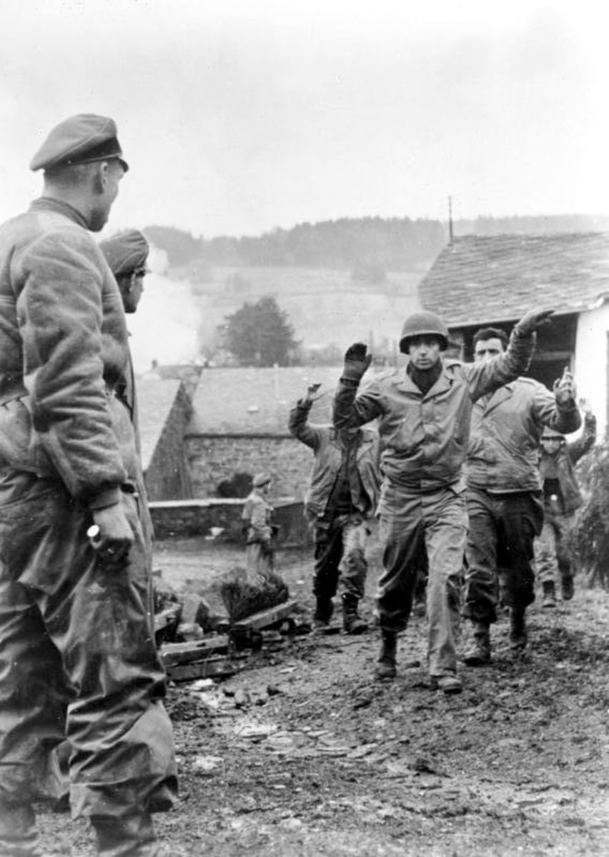 American troops surrendering to Waffen SS  troops in the Battle for the Ardennes. Note the Waffen SS soldier with his had on his dagger.