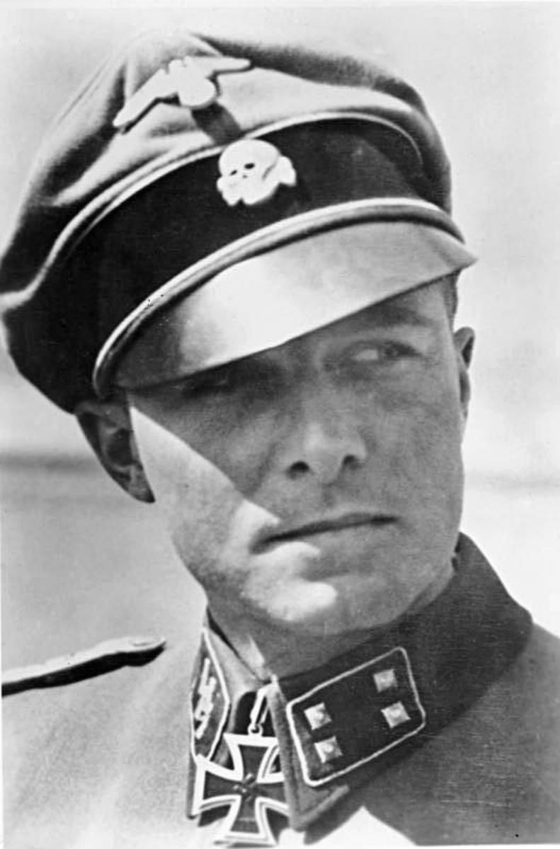 "Colonel Jochim Peiper in his 1st SS Panzer Division ""Leibstandarte"" Adolf Hitler uniform. The Death's Head insignia on his cap signifies loyalty to the death for the Fuhrer Adolf Hitler. He spoke excellent English."
