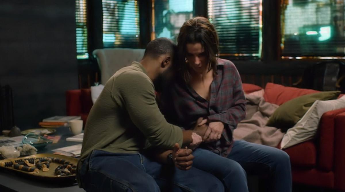 Tom (Trevante Rhodes) and Malorie (Sandra Bullock) share a special moment in 'Bird Box' (2018), a Netflix Original.