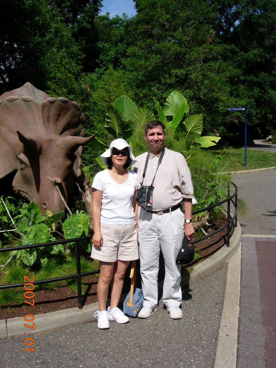 Posing with Uncle Beasley.  This triceratops model was moved from the National Mall to the National Zoo.  July 1, 2007