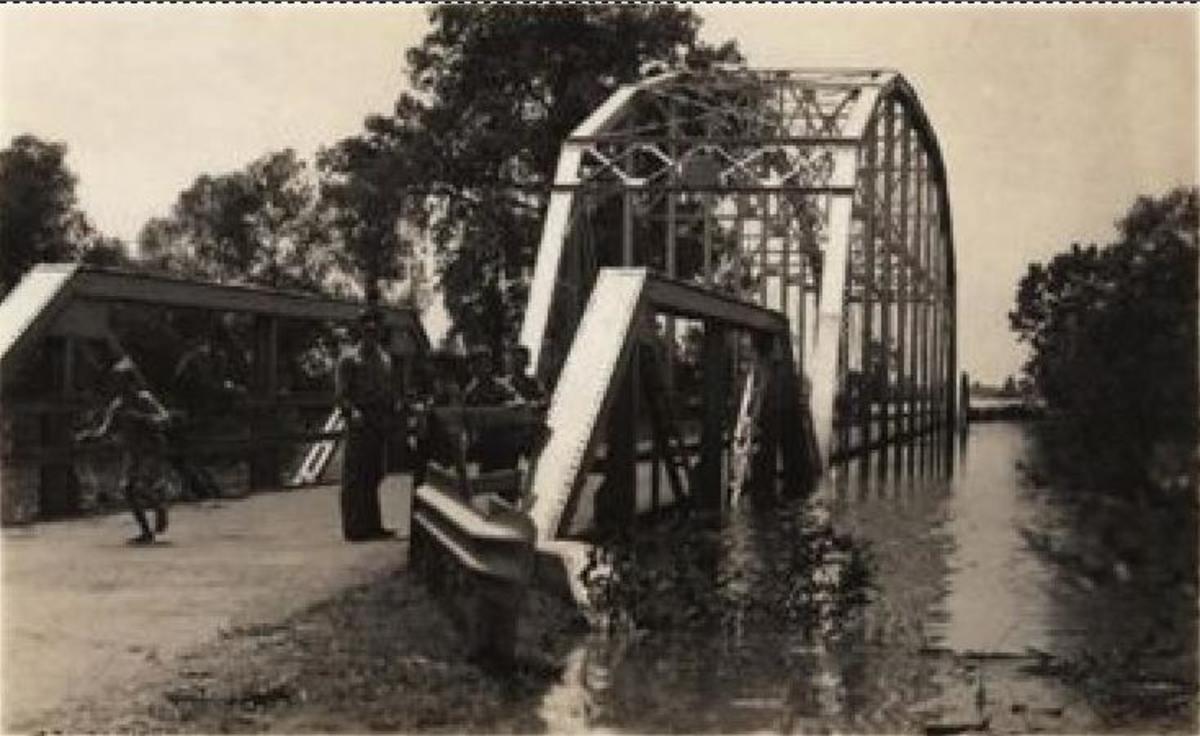 Poteau River Flood of 1943.  The US-271 Poteau River bridge during the May 1943 flood. Note the high water line on the right girder of the thru truss bridge.