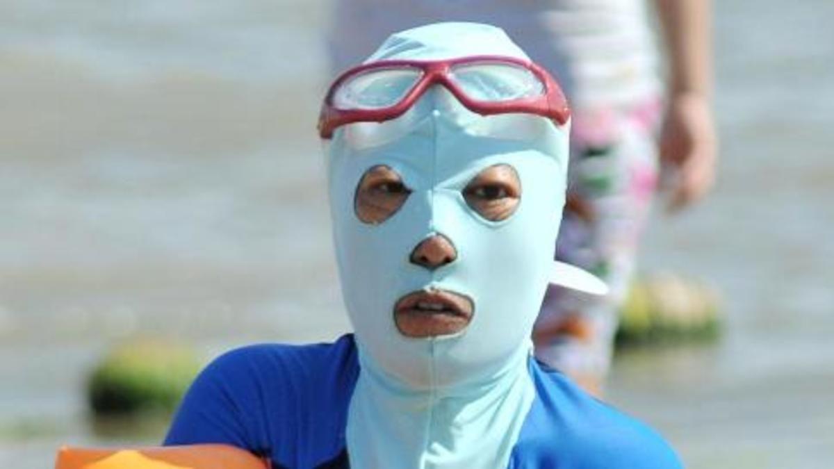 A beach goer sporting a facekini.