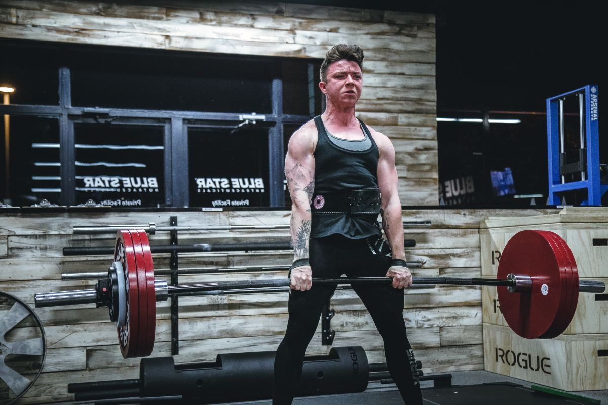 Deadlift (pick barbell up from the floor and straighten.)