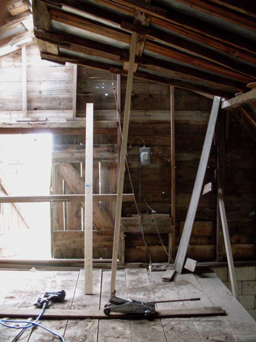Using a 2x6 and a floor jack, we gently pushed a small section if the roof into level. We started where the roof showed the least amount of damage.