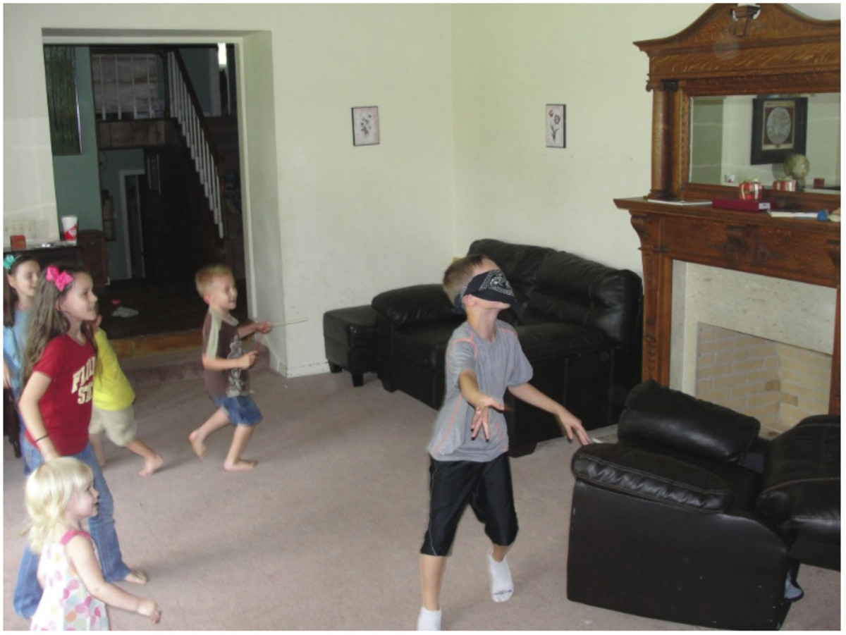 Playing Hoodman's Blind (today called Blind Man's Bluff) is one of the activities we did while learning more about the medieval period and the history sentence. You can see more at the above link: History Morning Basket & Activities.