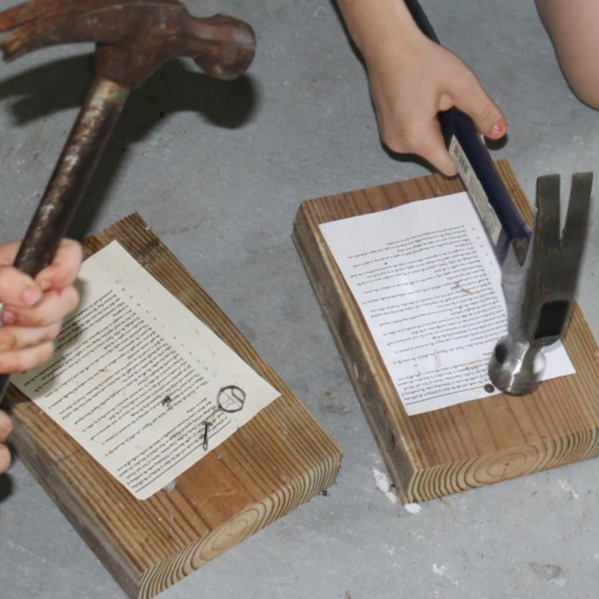 """Nailing copies of the """"Ninety-five Theses"""" was one of the activities we did this week during our History Morning Basket & Activities time on the Protestant Reformation."""