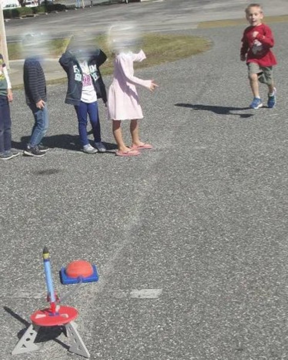 Taking turns shooting off stomp rockets -