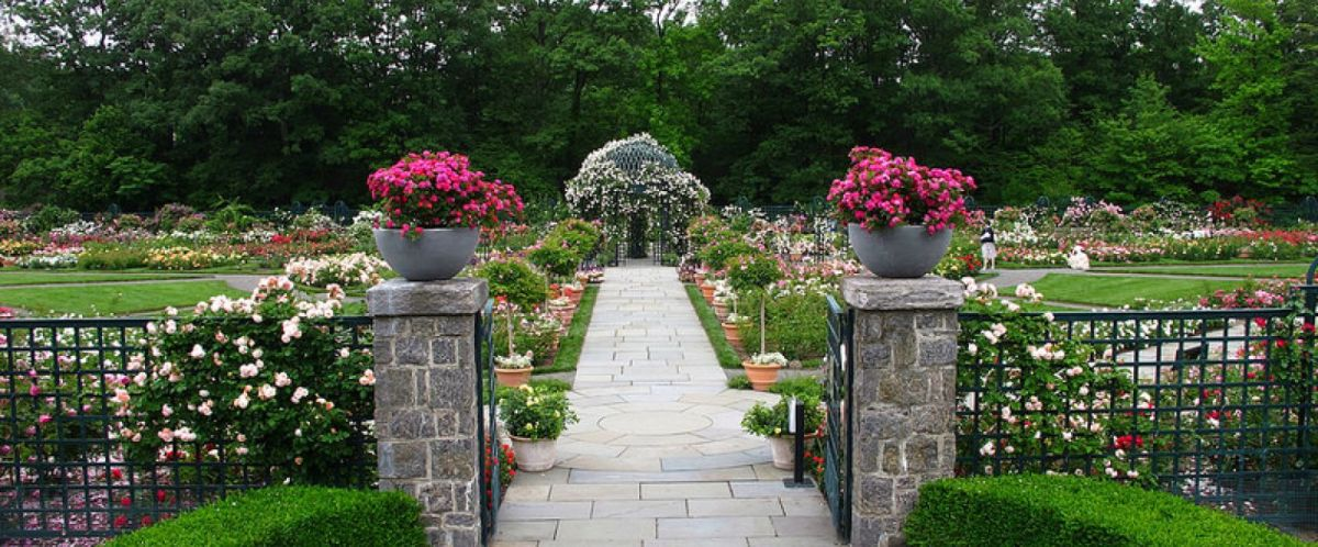 A typical garden perspective at the NY Botanical Garden entered by ornamental gateway