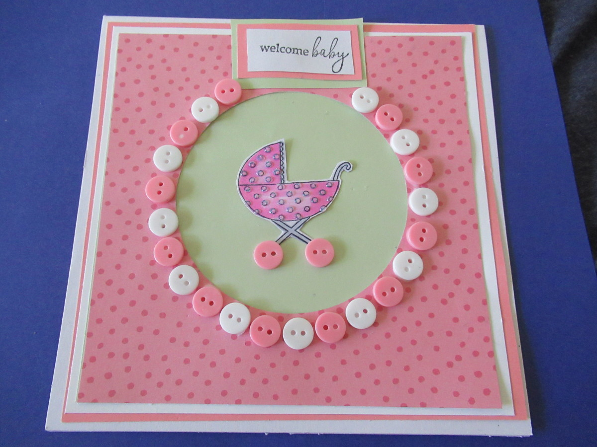 Use buttons to create a frame around a die cut.