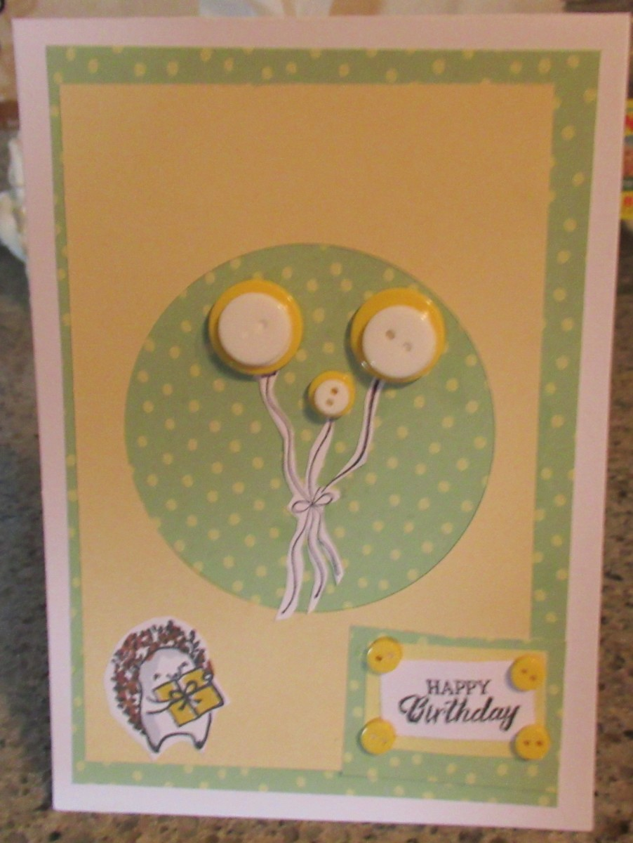 Paper and buttons from Crafter's Companion. Layer your buttons to create dimension and color