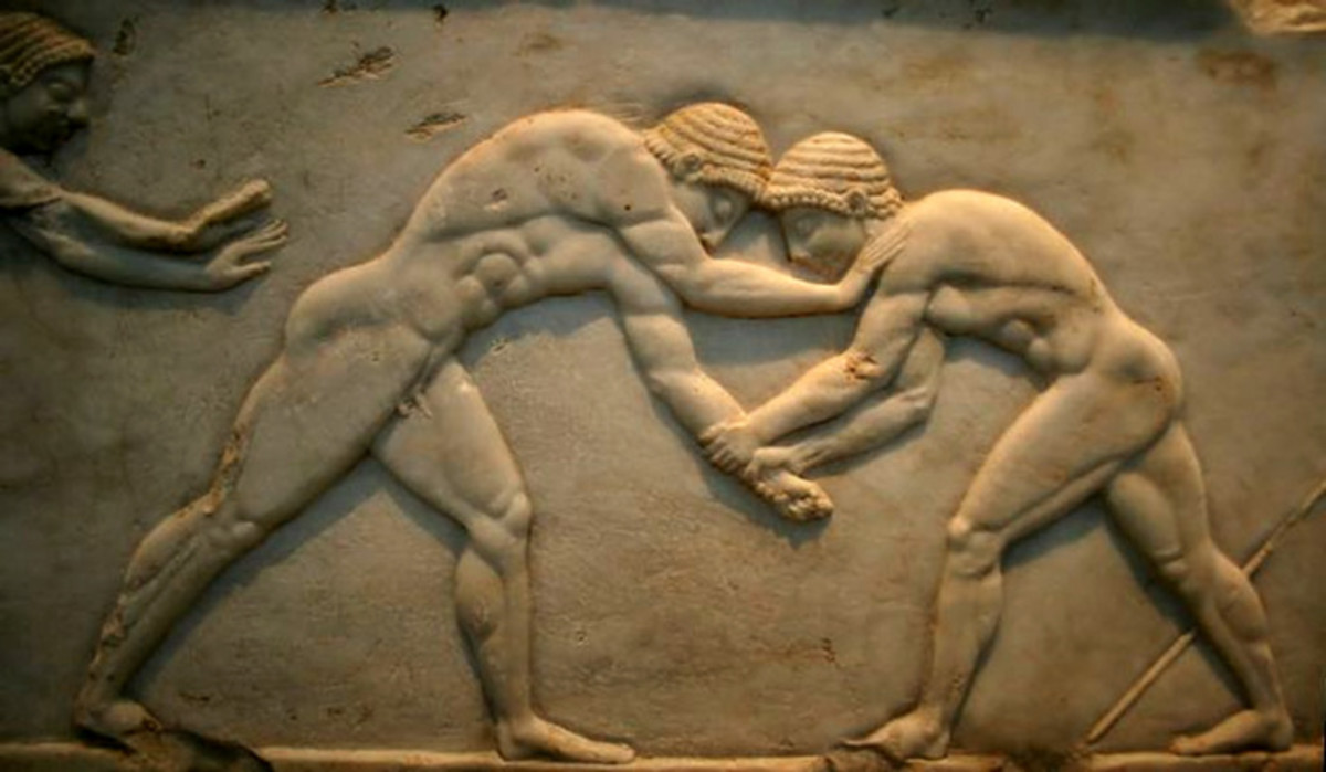 A relief showing wrestlers in the Olympiad.