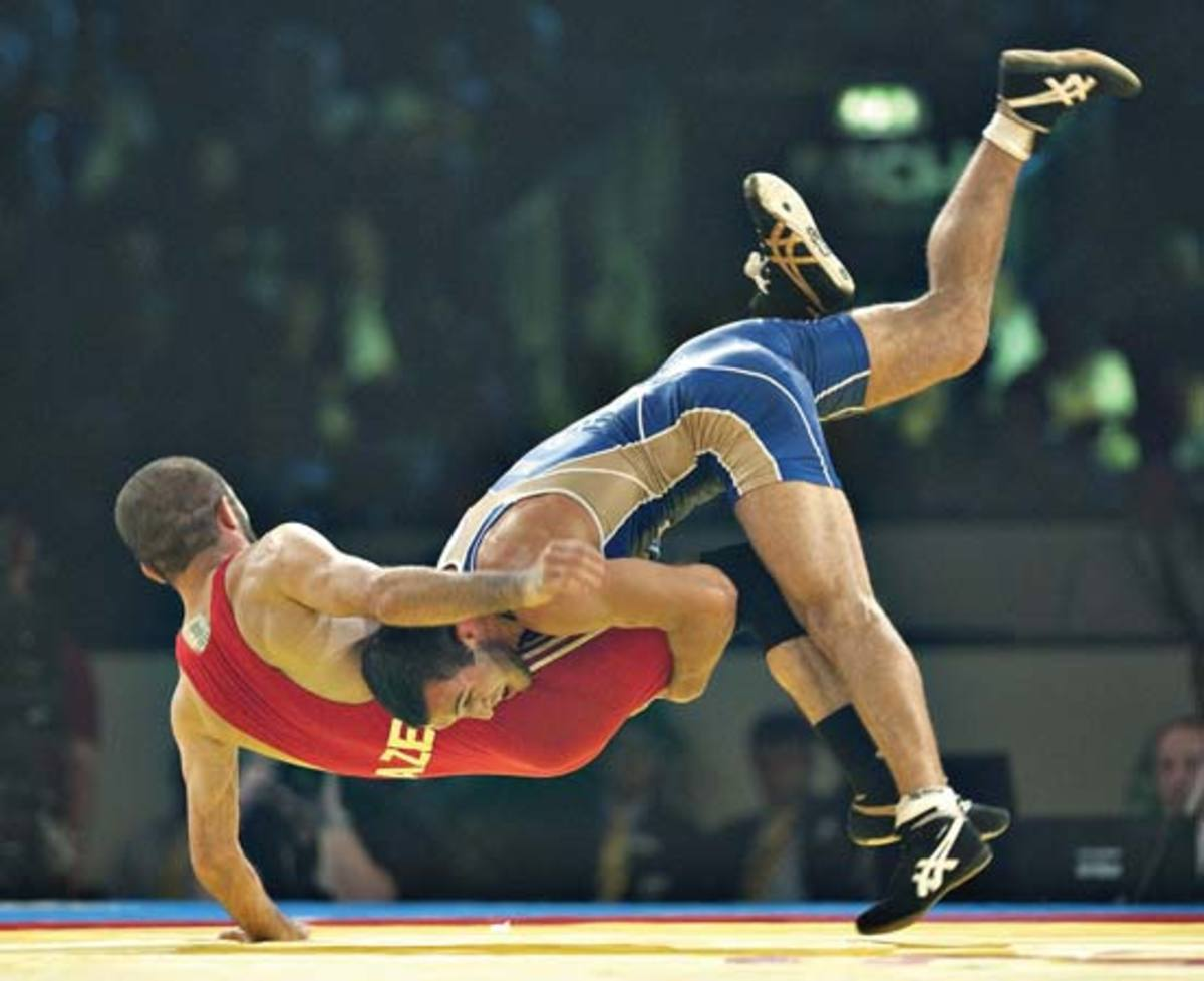 Freestyle wrestling, do note the hold below the belt during the double leg take-down.