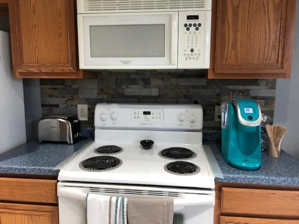 Here is what the kitchen area between the stove and microwave looks like.