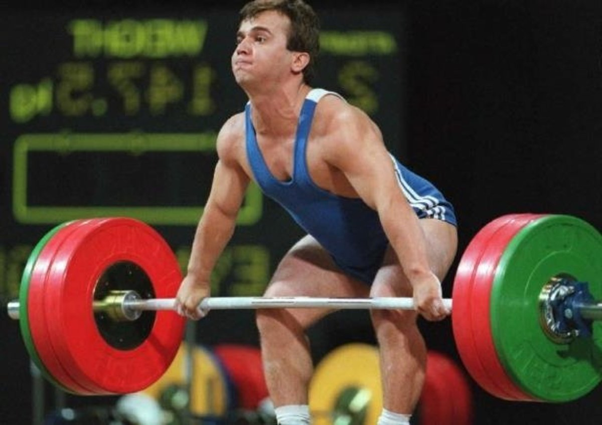 "Naim Suleymanoglu, nicknamed the ""Pocket Hercules"" for his small stature and brute strength. One of the greatest weightlifters of all time, he was the protégé of Coach Ivan Abatchiev, pioneer of the successful 'Bulgarian Method'."