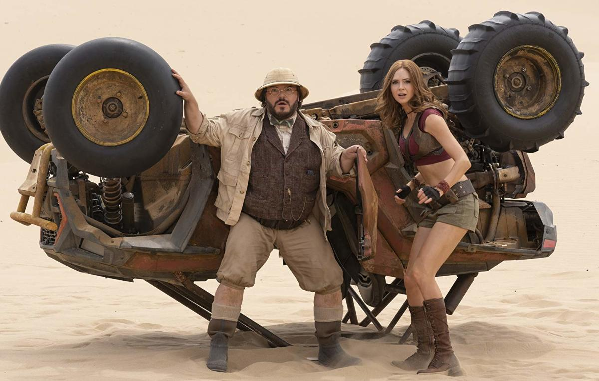 Karen Gillan is grateful she has hair in this movie. Jack Black is grateful for that hat.