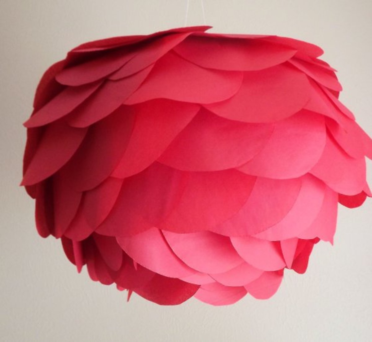 Cut the large tissue petals and glue or tape them onto a traditional round paper lantern.