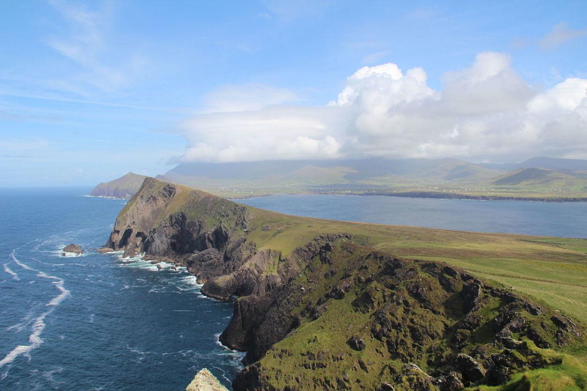 """""""An Triúr Deirféar"""" by Dáibhí Ó Bruadair ©2012. Smerwick can be seen in the gentle bay behind this majestic headland."""