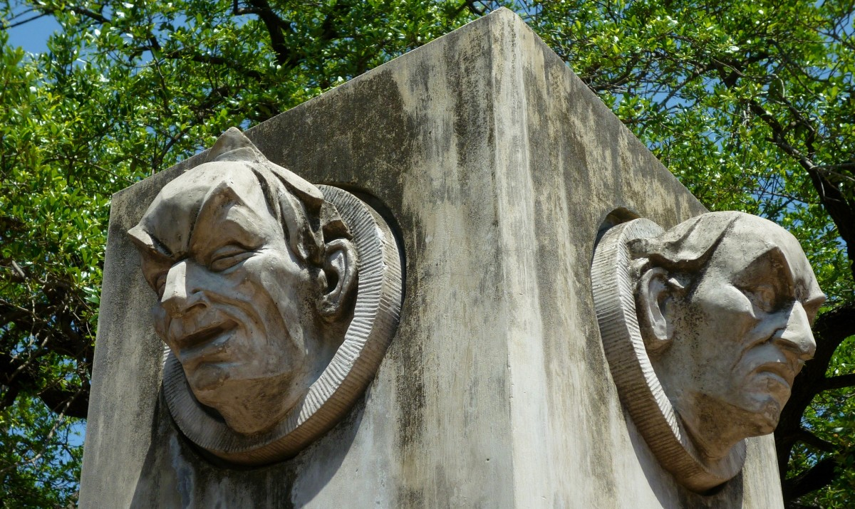 Sculpted faces with park chronology under it.