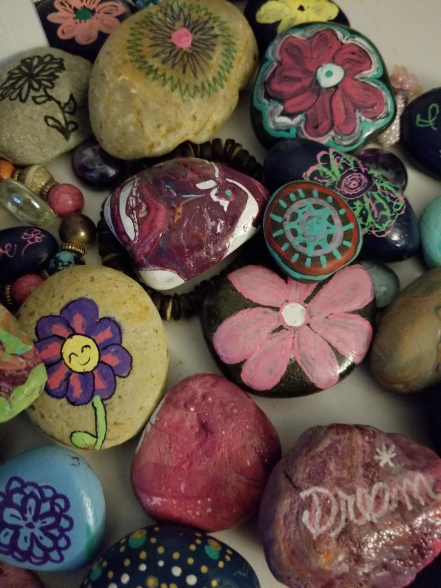 My first try at decorating rocks. I started 1 year ago and now I'm addicted!
