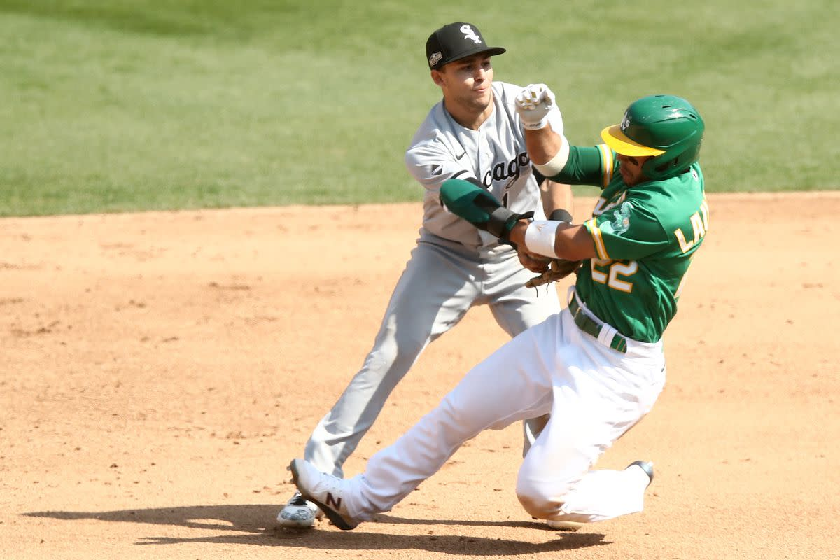 Nick Madrigal tag of Oakland A's Ramon Lauriano.