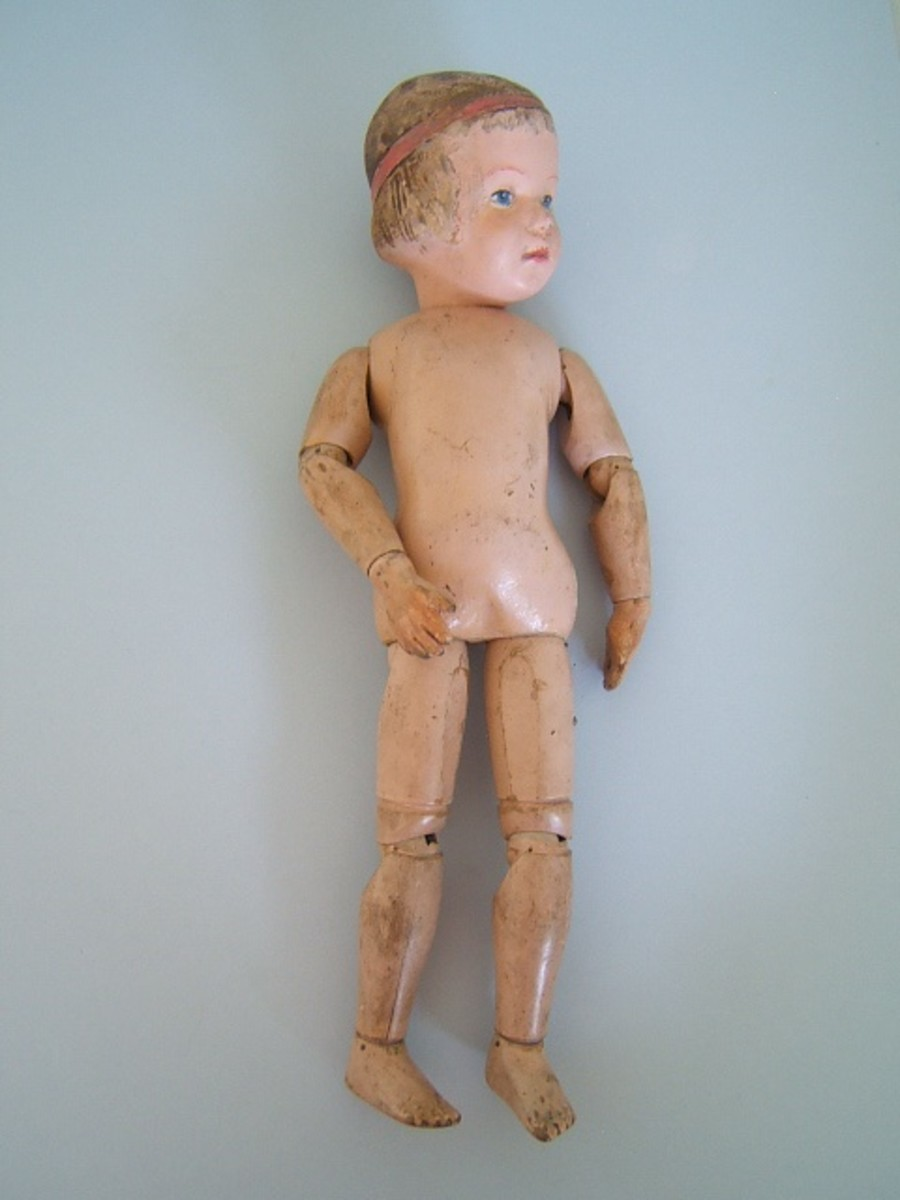 This doll fetched $599.00 at auction. As you see the antique Schoenhut dolls sell well holding value through the years.