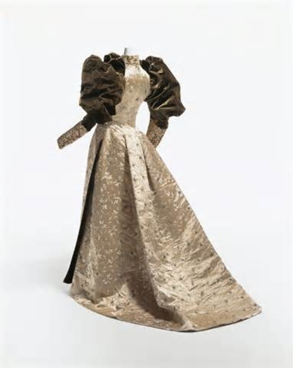1850s Wedding Gown - Note the puffed sleeve, and fitted waistline...
