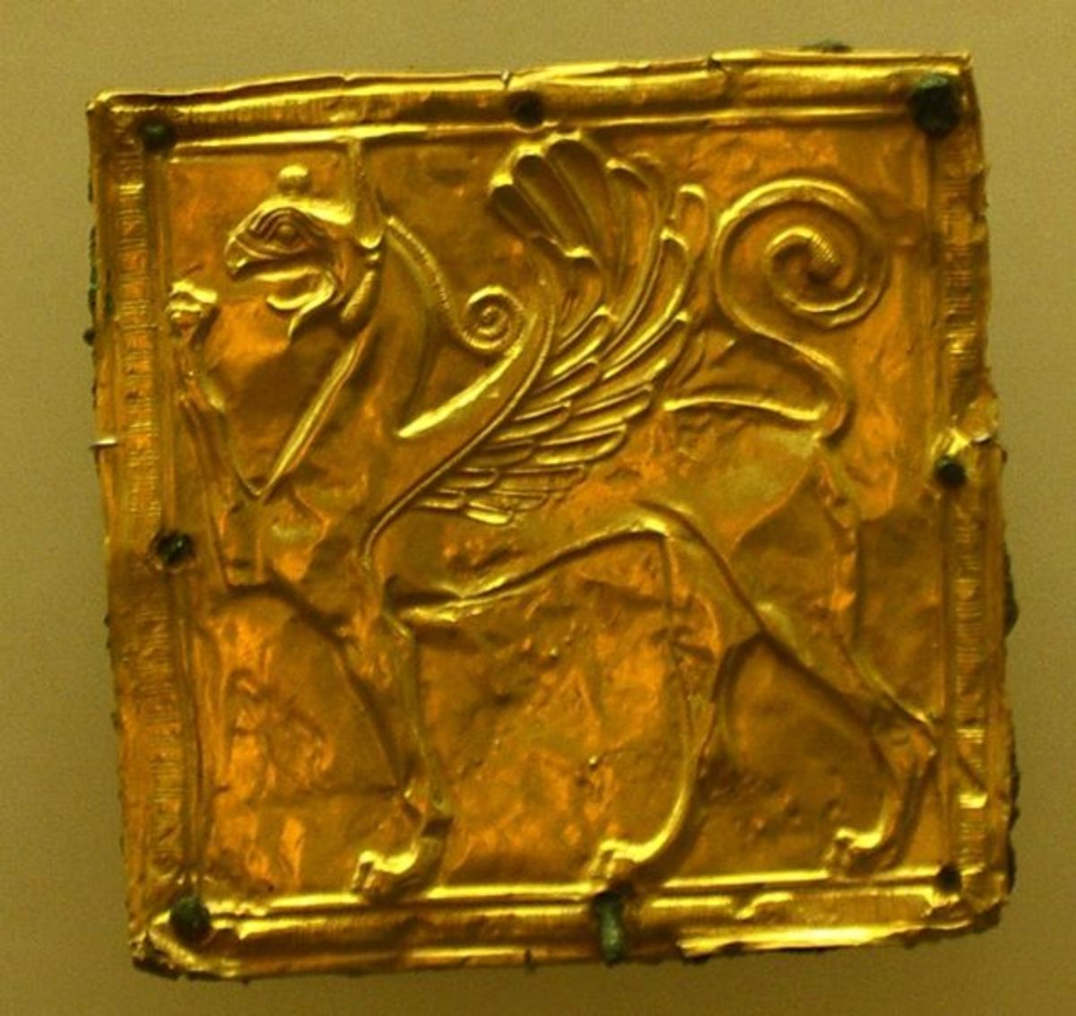 Found in the same rubbish heap as the gold and ivory Apollo and Artemis, this hammered gold griffin probably adorned a belt or clothes of the statue of a god. These damaged discards came from eastern cities-- some probably came from King Croesus!