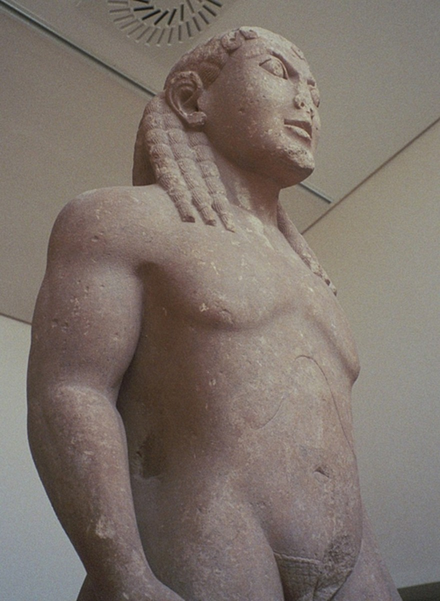 Biton, one of a pair of brothers -- see their story below. Archaic Greek art (another kouros figure), 610-580BCE. About 7 feet (2.15) meters tall.