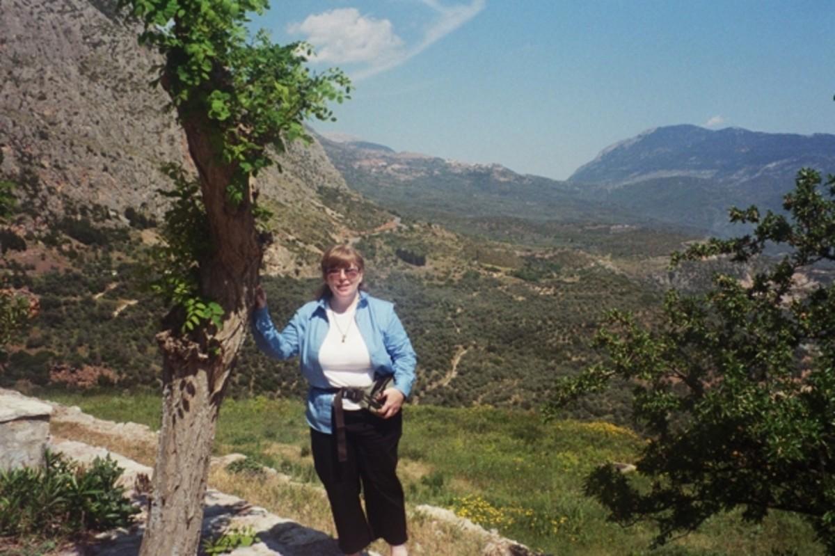 Greekgeek standing in front of a Treasury.