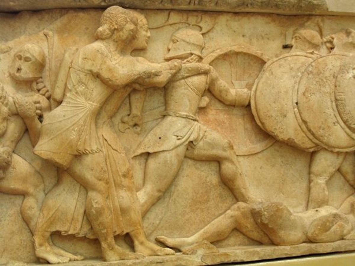 Siphnian Treasury, close-up of Apollo (short tunic) and his twin sister Artemis (longer gown) taking on the Giants.
