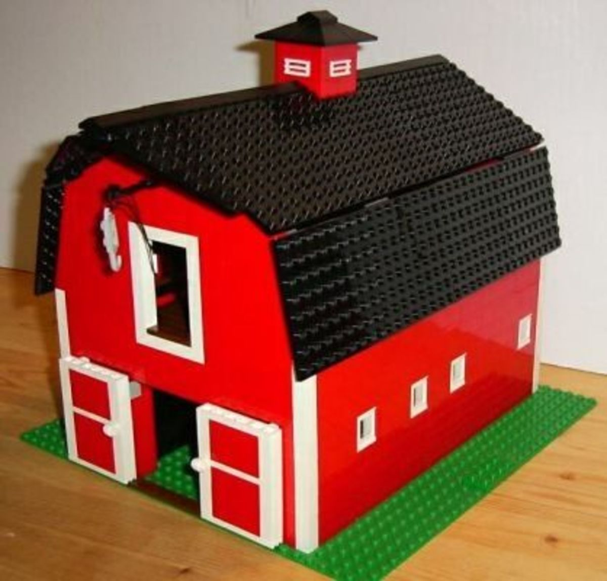 Classic red barn to go with the farmhouse, sliding doors operate, interior stalls for livestock, upper floor hay and grain storage with crane to loading door.