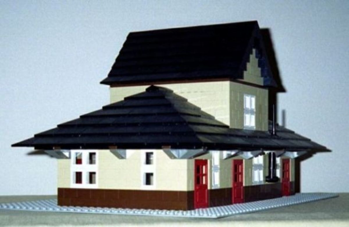 Old fashioned North American style railroad depot with ticket office, waiting room with heating stove, freight room, etc