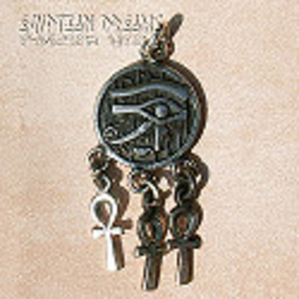 The eye of Horus and ankh symbols (fertility symbols - note the cross shape).