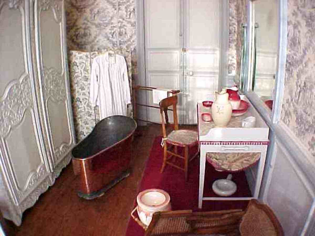 "Cabinet de Toilette, here you can see a few 18 century bathroom fittings and a stunning 19th century copper bathtub.  This ""bathroom"" separates two bedrooms."