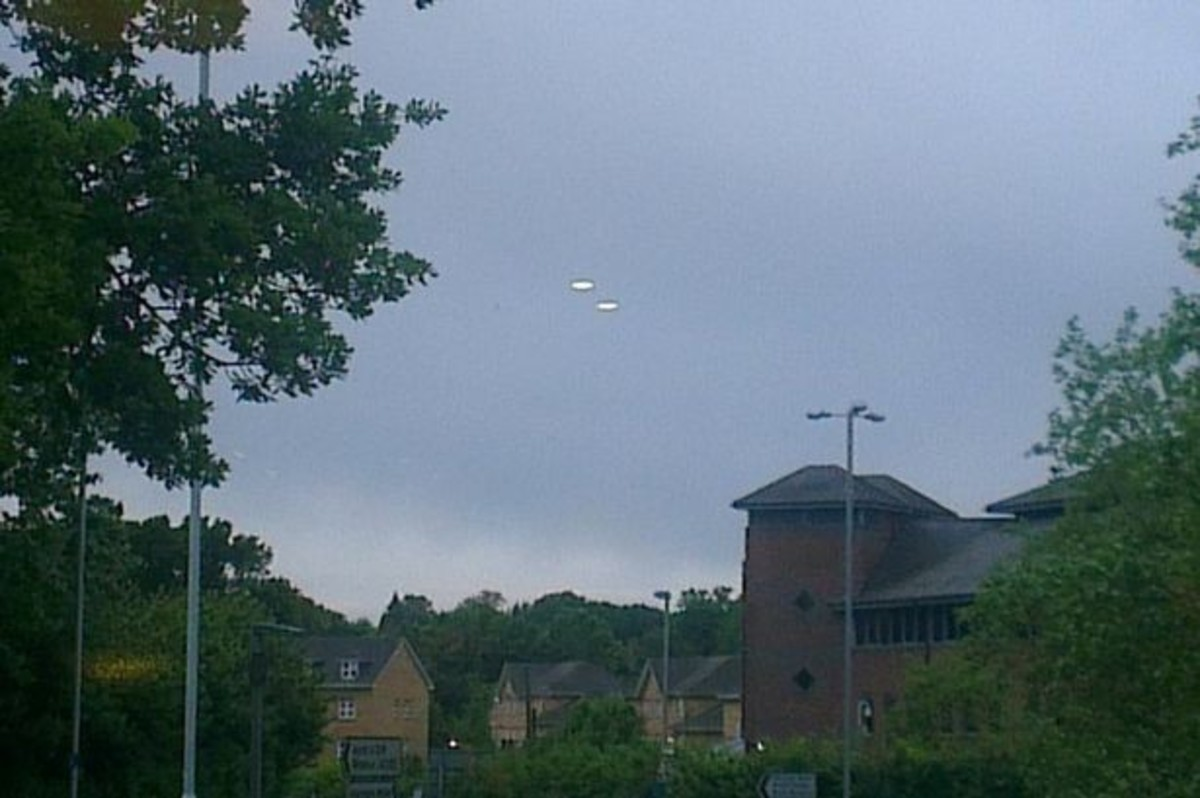 """Steve Lambert caught these two UFOs on camera hovering over the skies of Bracknell, Berkshire, on the night of Friday 14 June, 2013. """"They were heading south-west at high speed towards Basingstoke - quicker than any normal aircraft."""