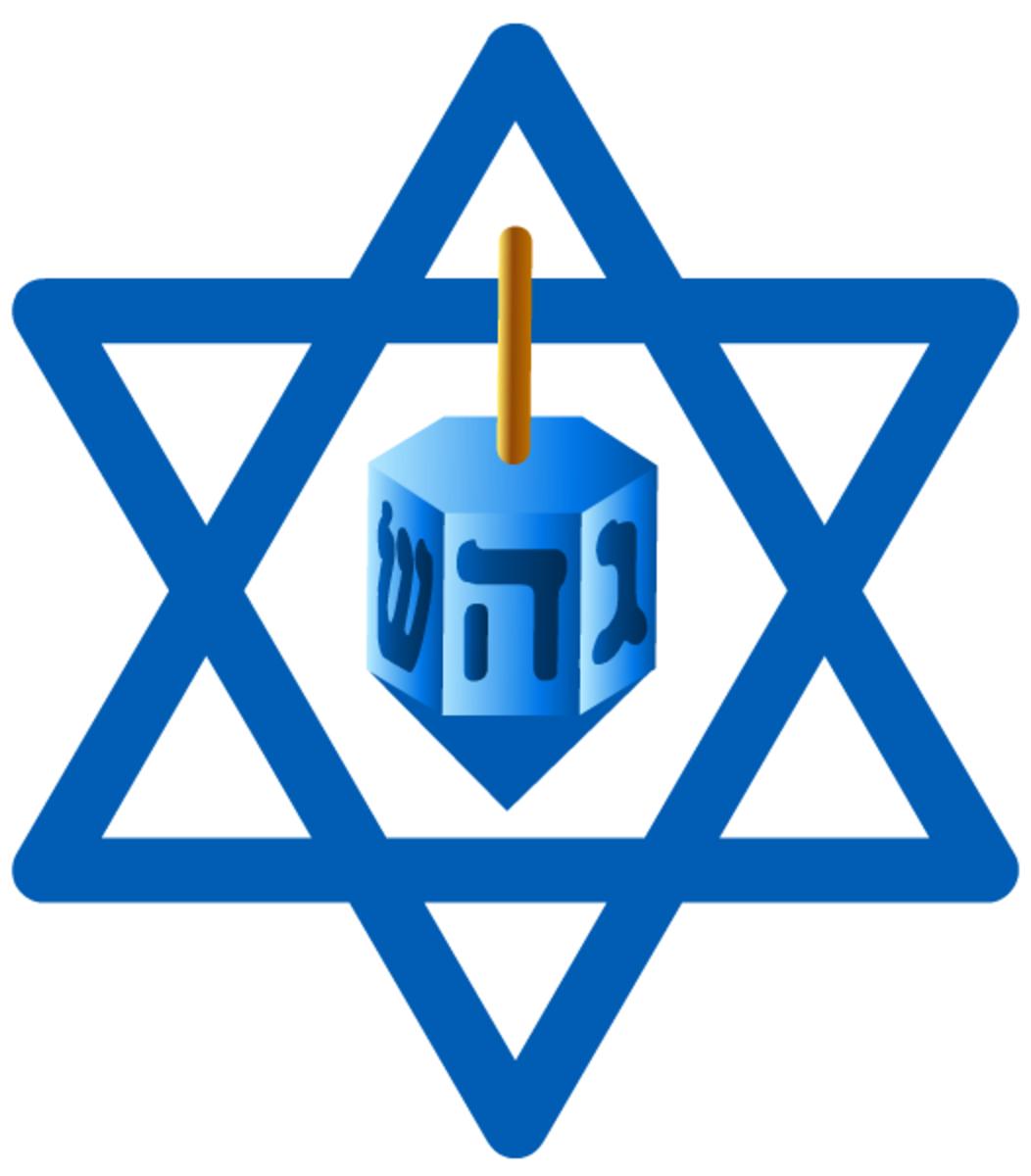 Hanukkah symbols: dreidel and star of David