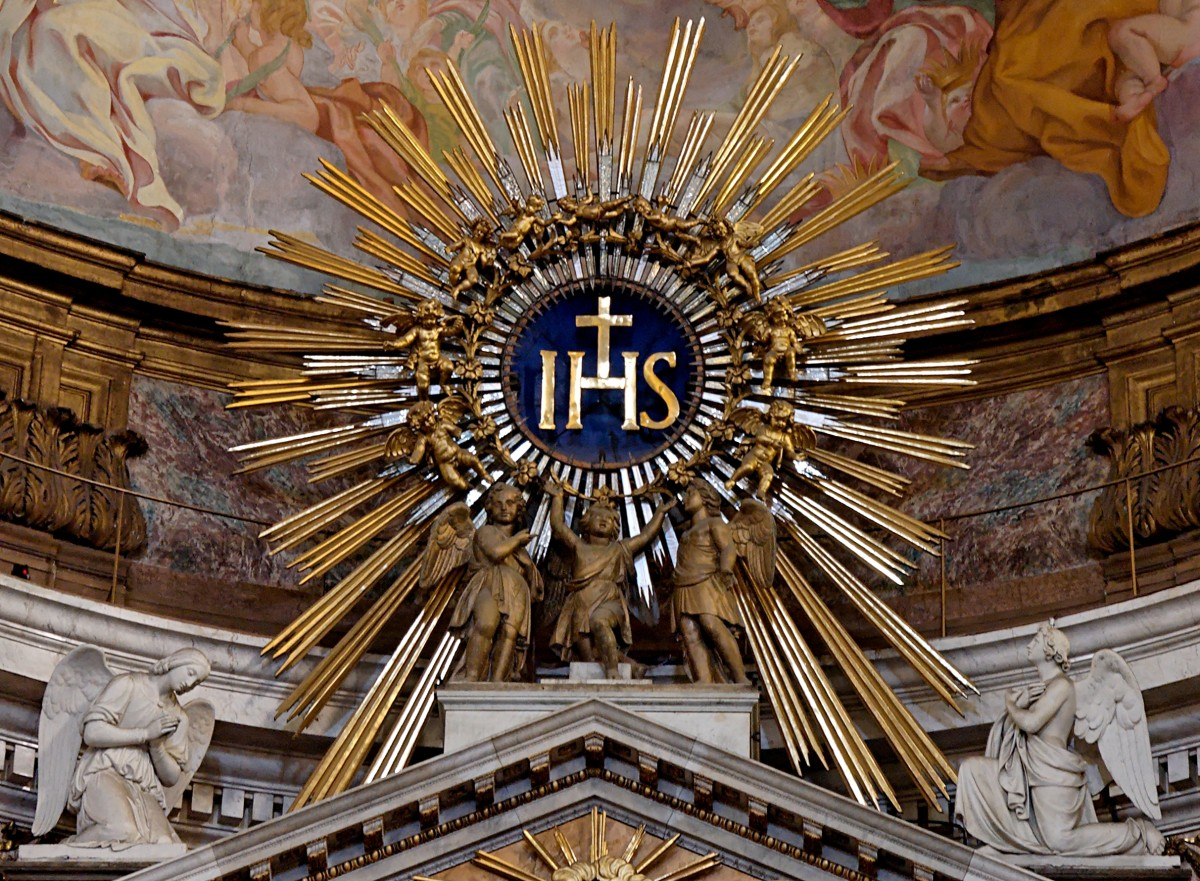 "IHS  with the Cross the monogram and Logo of the Jesuits, the sign means In Hoc Signo. In this sign ""the cross"" they will conquer."
